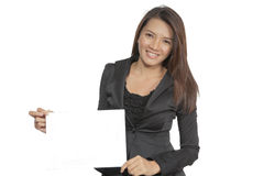 Young Asian business woman attractive brunetee showing blank sig. Happy smiling young pretty attractive brunette Asian business woman standing positive showing Royalty Free Stock Photos