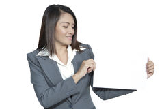 Young Asian business woman attractive brunetee showing blank sig. Happy smiling young pretty attractive brunette Asian business woman standing positive showing Stock Photos