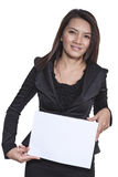Young Asian business woman attractive brunetee showing blank sig Royalty Free Stock Images
