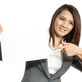 Young Asian business woman attractive brunetee showing blank sig Royalty Free Stock Photo