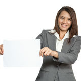 Young Asian business woman attractive brunetee showing blank sig Royalty Free Stock Image