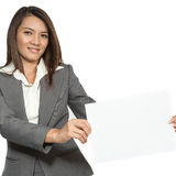 Young Asian business woman attractive brunetee showing blank sig Stock Photography