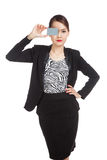 Young Asian business woman with a blank card over her eye Royalty Free Stock Images
