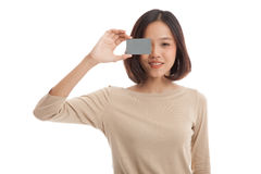 Young Asian business woman with  blank card over her eye Royalty Free Stock Photography