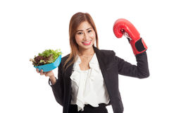 Young Asian business woman with boxing glove and salad Stock Images