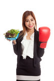 Young Asian business woman with boxing glove and salad Stock Photo