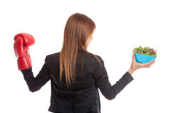 Young Asian business woman with boxing glove and salad Stock Photos