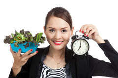 Young Asian business woman with clock and salad Royalty Free Stock Image