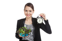 Young Asian business woman with clock and salad Royalty Free Stock Images