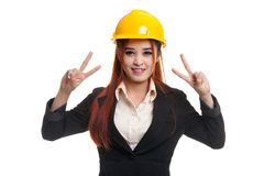 Young Asian business woman with clock and salad. Royalty Free Stock Image