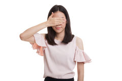 Young Asian business woman close her eyes with hand. Royalty Free Stock Images
