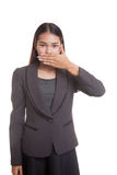 Young Asian business woman close her mouth with hand. Stock Photos