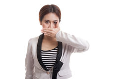 Young Asian business woman close her mouth with hand. Stock Images