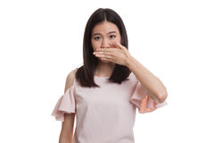 Young Asian business woman close her mouth with hand. Stock Photo