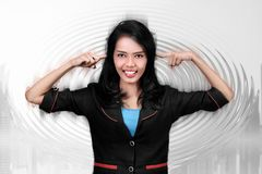 Young asian business woman closing her ears Royalty Free Stock Photos