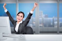 Young asian business woman with computer on desk with happy expr. Ession in the office Stock Images