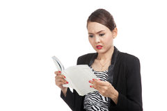 Young Asian business woman confused with a book Stock Photography