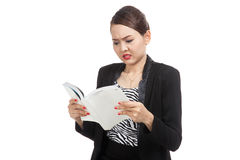 Young Asian business woman confused with a book Royalty Free Stock Images