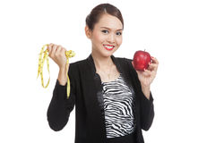 Young Asian business woman diet with red apple and  measuring ta Stock Images