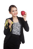 Young Asian business woman diet with red apple and  measuring ta Royalty Free Stock Photo
