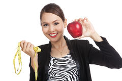 Young Asian business woman diet with red apple and  measuring ta Royalty Free Stock Image