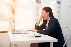 Free Young Asian Business Woman Dozy On The Desk In Office Because Tired Overworked. Royalty Free Stock Images - 155686089