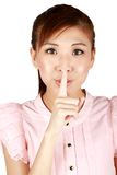 Young Asian business woman with finger on lips. Stock Images
