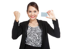 Young Asian business woman fist pump with a blank card Stock Photos