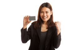 Young Asian business woman fist pump with blank card. Royalty Free Stock Photography