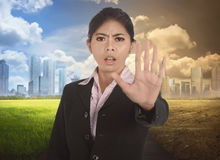 Young asian business woman with gesture to stop changing environment. In the modern city stock photos