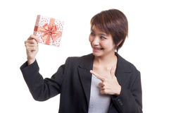 Young Asian business woman with a gift box. Royalty Free Stock Images
