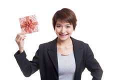 Young Asian business woman with a gift box. Royalty Free Stock Photography