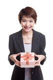 Young Asian business woman with a gift box. Royalty Free Stock Image