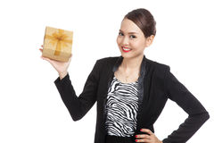 Young Asian business woman with a golden gift box Stock Photo