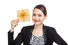 Young Asian business woman with a golden gift box. Isolated on white background Royalty Free Stock Photos