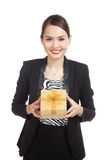 Young Asian business woman with a golden gift box Royalty Free Stock Photos