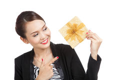 Young Asian business woman with a golden gift box. Isolated on white background Royalty Free Stock Photo