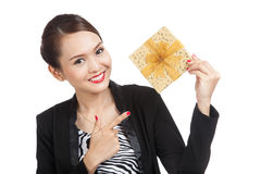 Young Asian business woman with a golden gift box. Isolated on white background Royalty Free Stock Image