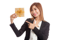 Young Asian business woman with a golden gift box. Isolated on white background Stock Photo