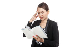 Young Asian business woman  got headache read a book Stock Images