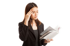 Young Asian business woman  got headache read a book. Royalty Free Stock Photography