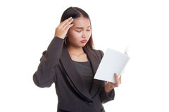 Young Asian business woman  got headache read a book. Stock Image