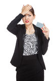 Young Asian business woman headache with a blank card Stock Photography