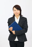 Young Asian Business Woman Holding A Book Royalty Free Stock Image
