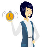 Young asian business woman holding alarm clock. Royalty Free Stock Photography