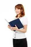 Young asian business woman holding a book Stock Photo