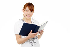 Young asian business woman holding a book Stock Images