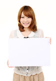 Young asian business woman holding empty white boa Stock Image