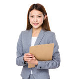 Young asian business woman holding file document Royalty Free Stock Photo