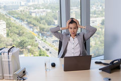 Young asian business woman with notebook in the office. In high floor in front of the window Stock Photography